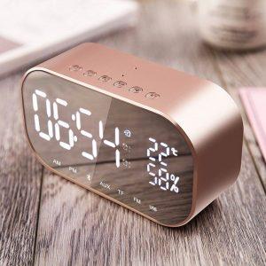 radio despertador dorada