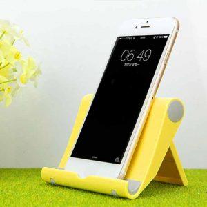 soporte para móvil amarillo
